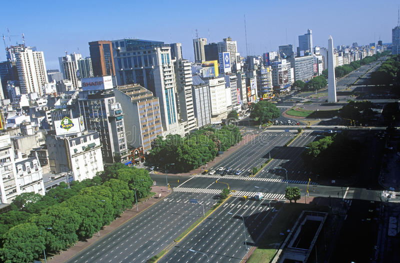 Avenida 9 de Julio, widest avenue in the world, and El Obelisco, The Obelisk, Buenos Aires, Argentina royalty free stock images