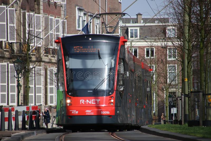 Avenio R-NET red black street car tram on line 15 on the Vijverberg in The Hague in The Netherlands royalty free stock images