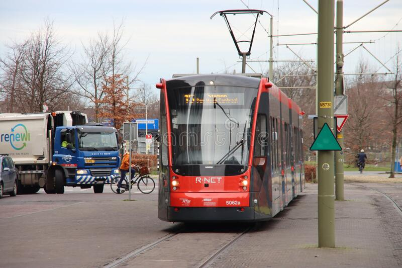 Avenio red and black trams runned by HTM for R-NET at Den Haag Central train station on the street stock images