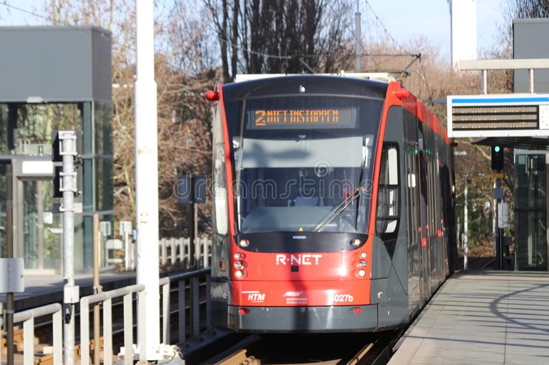 Avenio Siemens train of the HTM R-NET 5027 on line 2 without service at tram station Ternoot in The Hague. stock image