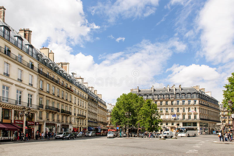 Avenue de l'Opera and Rue Saint Honore. PARIS, FRANCE - AUG 18, 2014: Avenue de l'Opera and Rue Saint Honore in the center of Paris with cars and pedestrians on royalty free stock photos