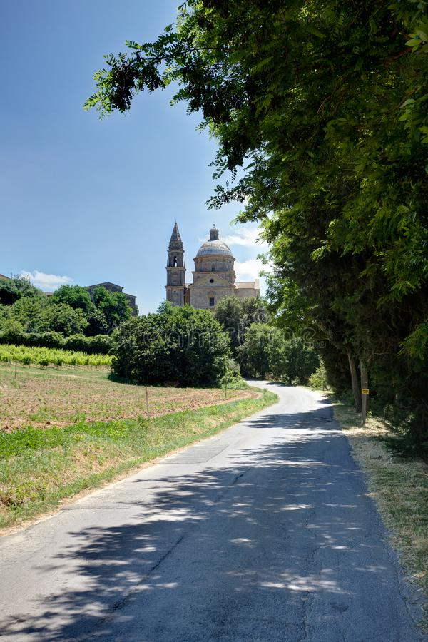 Avenue San Biagio Church, Montepulciano, Tuscany, Italy. Avenue with trees and the San Biagio Church in the sun and under the blue sky of Montepulciano, Tuscany stock photography