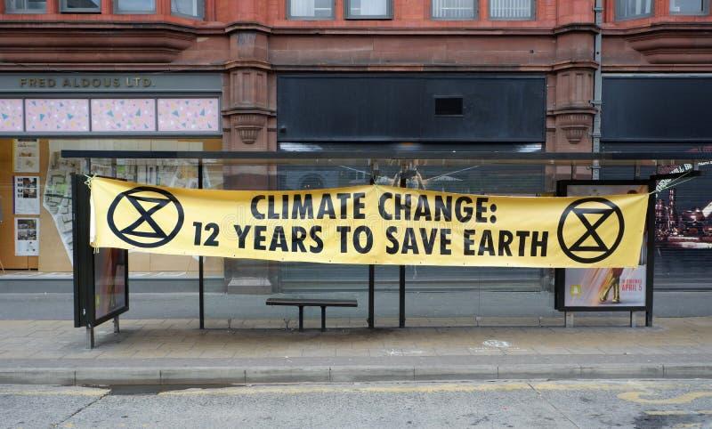 Avertissement de changement climatique de rébellion d'extinction à Manchester images libres de droits