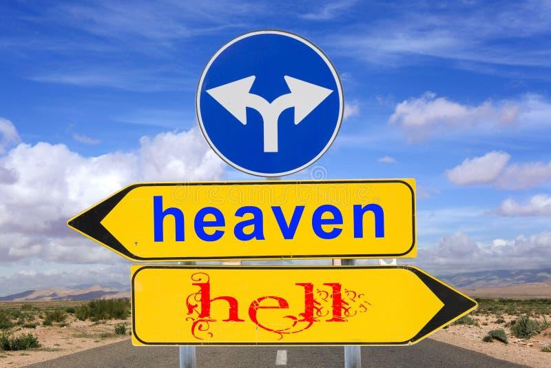 Avertissement de signe de route de ciel et d'enfer images stock