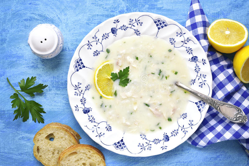 Avgolemono - traditional greek chicken soup with lemon and eggs. royalty free stock photos