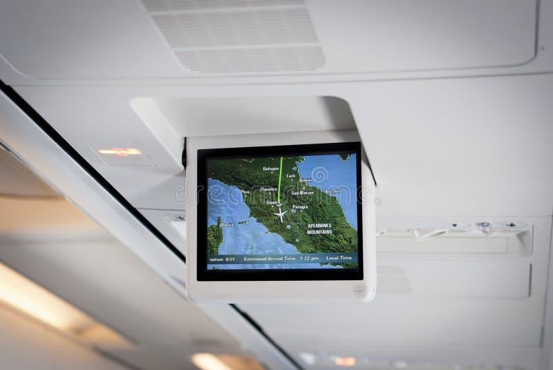 Avião de passageiros. Sistema movente do mapa fotografia de stock royalty free