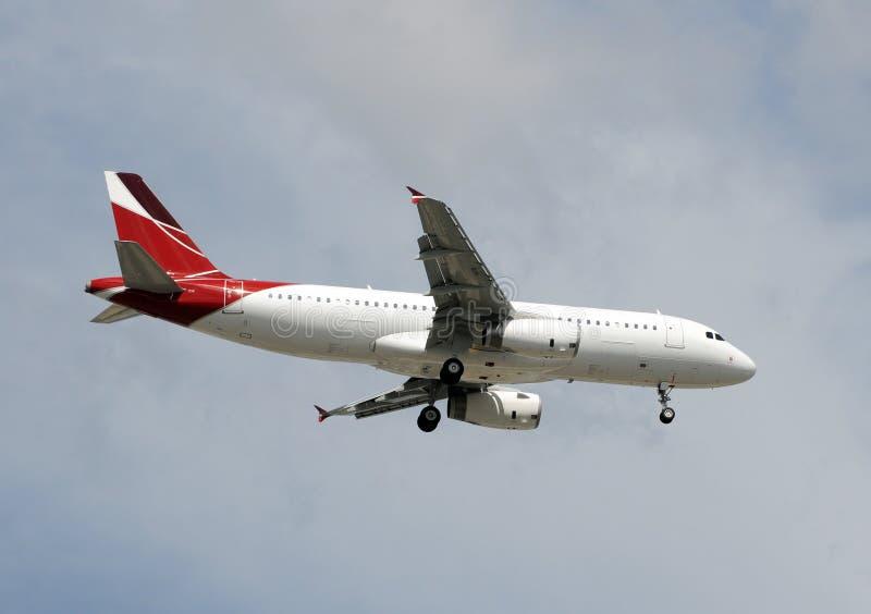 Avião de passagem imagens de stock royalty free