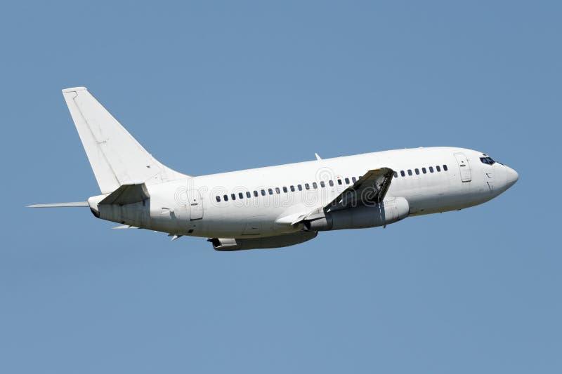 Avião estreito branco do jato do corpo fotografia de stock royalty free