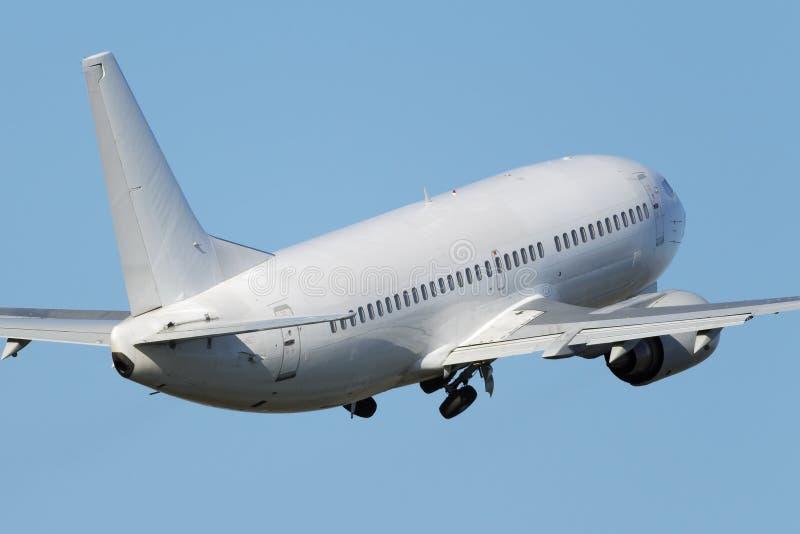 Avião estreito branco do jato do corpo imagem de stock