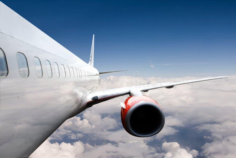 Avião no vôo fotografia de stock royalty free