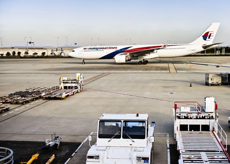 Avión de Malaysia Airlines aterrizado fotos de archivo