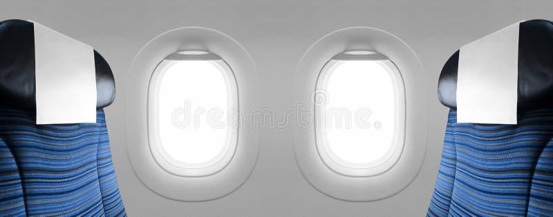 Avión en blanco de dos ventanas con los asientos azules foto de archivo libre de regalías