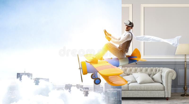 Aviateur sur le rétro avion Media m?lang? photographie stock