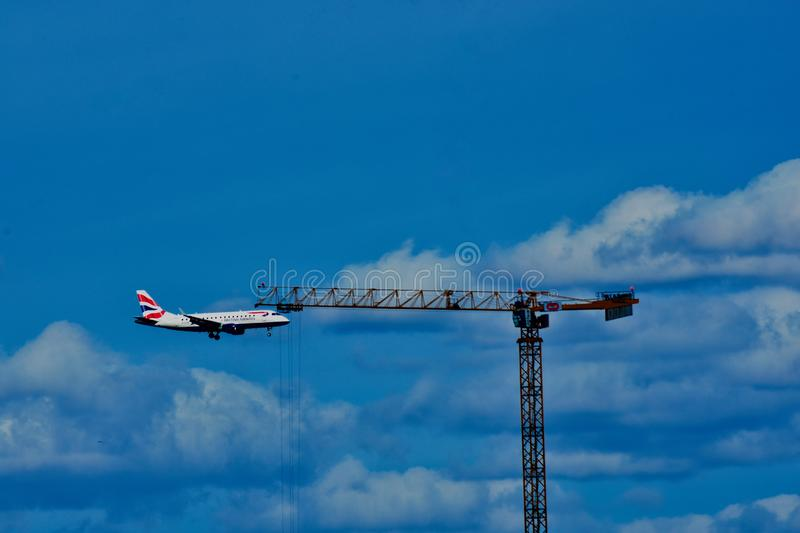 Aviation and building construction in the air royalty free stock photography