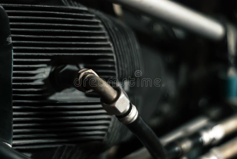 Aviation engine cylinder fragment. Fragment of the cylinder of an aircraft piston engine with a fuel supply system, partially blurred background stock photos