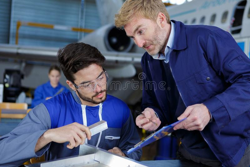 Aviation engineer in duscussion with superior stock photos