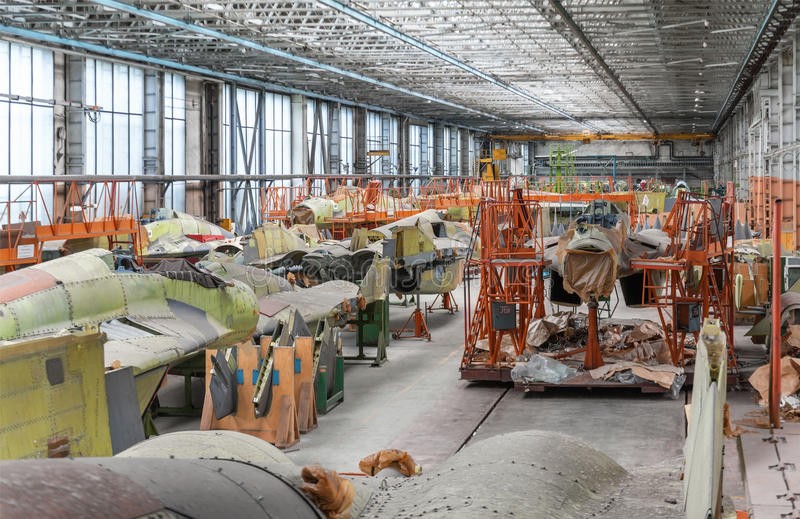 Download Aviation Factory Of Military Aircraft. Assembly Of The Russian Multirole Fighter. Room With Several Stock Photo - Image: 68078658