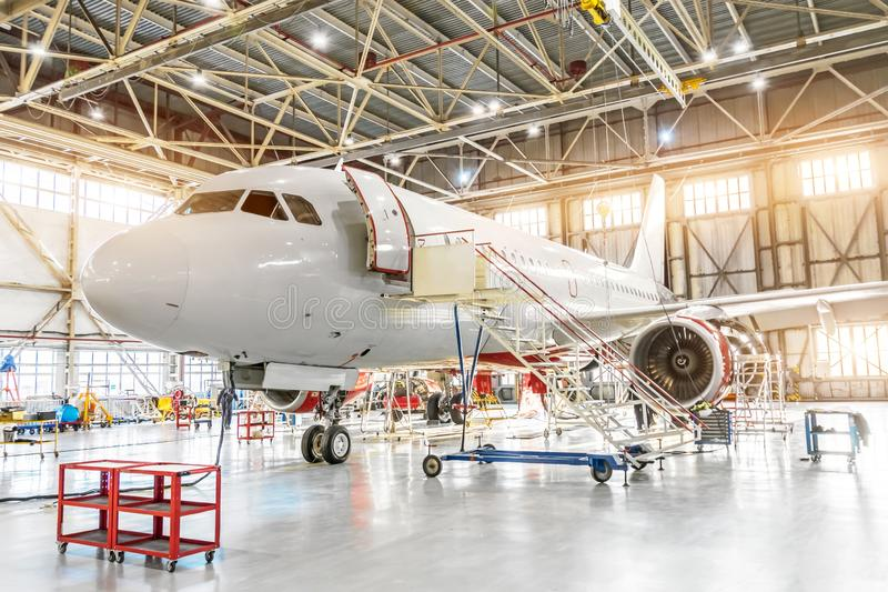 Aviation hangar with passenger aircraft jet for maintenance.  royalty free stock image