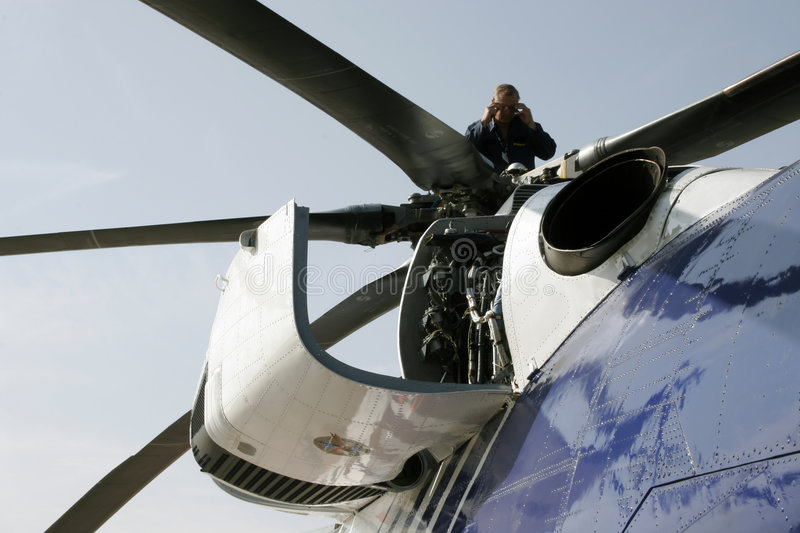 Aviation Mechanical Enginerr Is Reviewing The Helicopter Engine royalty free stock image