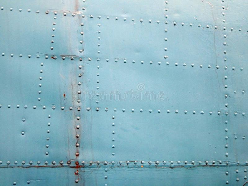 Aviation textures plating of aircraft and helicopter. Rivets stock photo