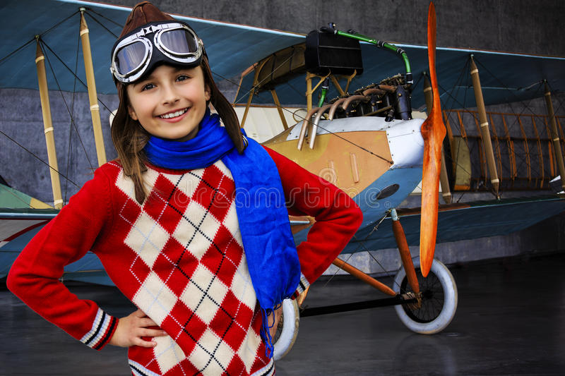Aviator, happy girl ready to travel with plane. royalty free stock photography