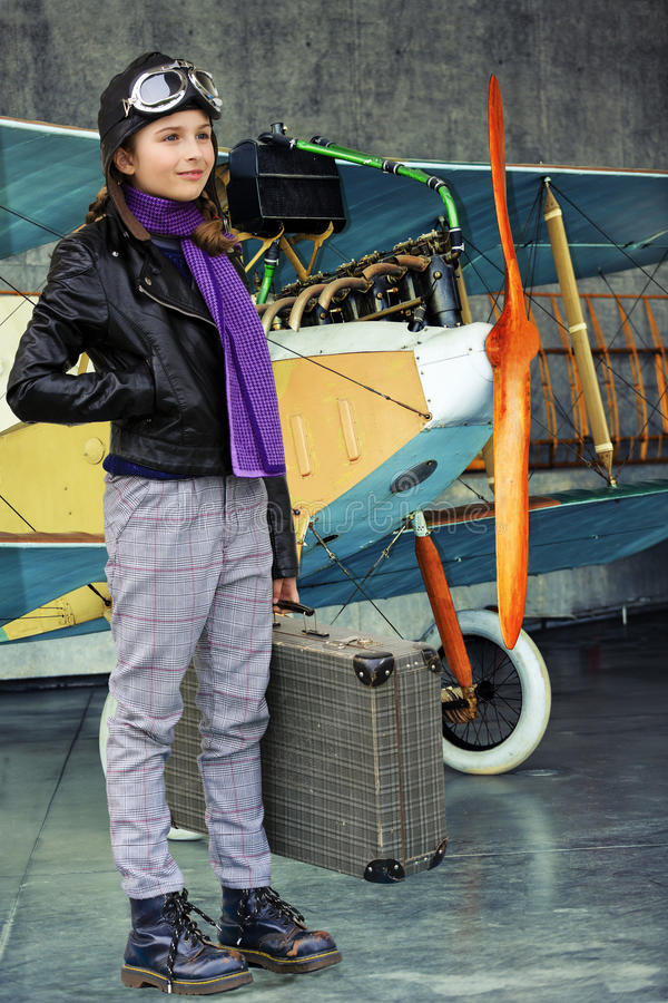 Aviator, happy girl ready to travel with plane. stock images