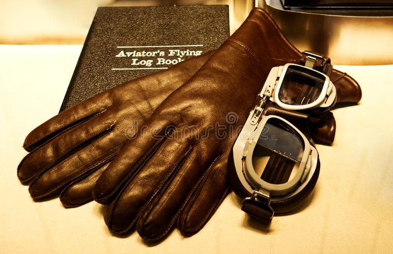 Aviator`s flying log book. Log book, pilot gloves and glasses royalty free stock photography
