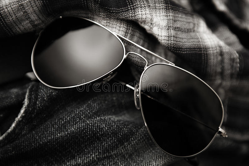 Aviator sunglasses grunge jeans plaid royalty free stock photo