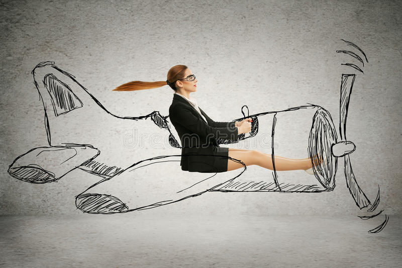 Aviator woman with scarf and glasses flying designed airplane stock images