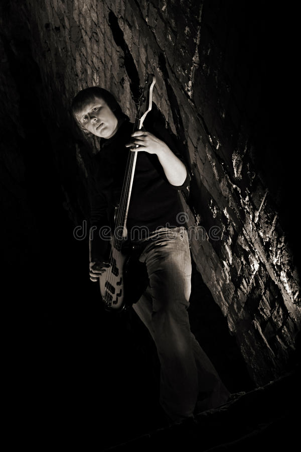 An avid guitarist in the ruins. Of an old fortress royalty free stock images