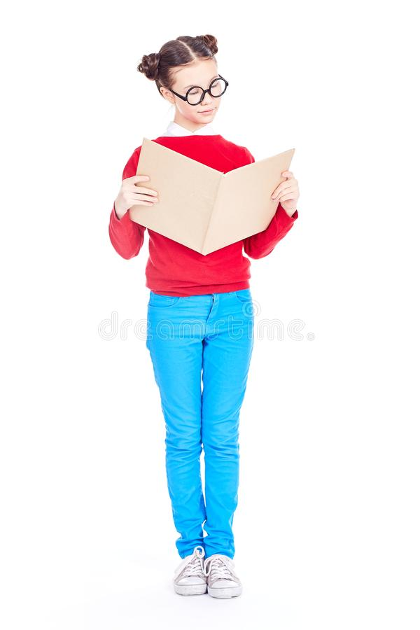 Avid reader. Portrait of Asian school girl with nerd eyeglasses holding open book, isolated on white stock images