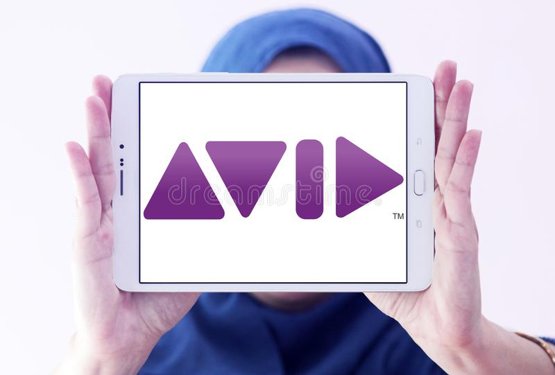 Avid Technology company logo. Logo of Avid Technology company on samsung tablet holded by arab muslim woman. Avid Technology is an American technology and royalty free stock photo