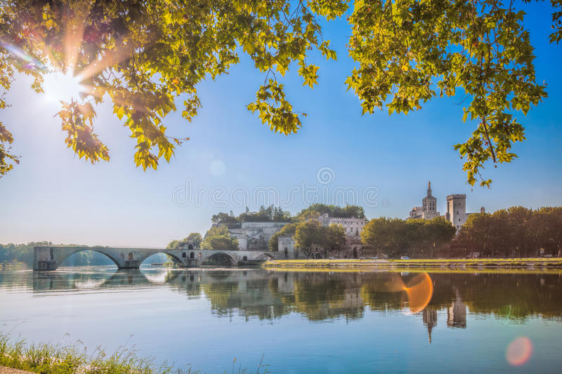 Avignon bridge with Popes Palace in Provence, France stock photography