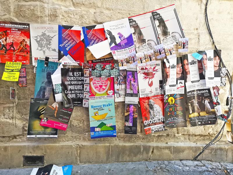Avignon Theatre Festival. Avignon, France 28 Juillet 2019: Plenty of playbills on a wall during famous theatre festival from July 4 to 28 2019 in Avignon, south royalty free stock photos