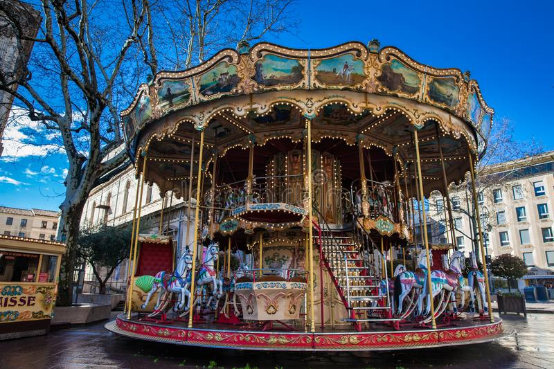 French old-fashioned style carousel with stairs at Place de Horloge in Avignon France royalty free stock image