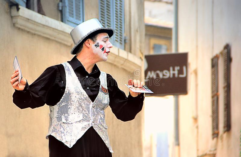 Avignon Theatre Festival. AVIGNON, FRANCE – JULY 19, 2014: Actor on stilts advertising his performance during famous theatre festival from July 4 to 27 stock image