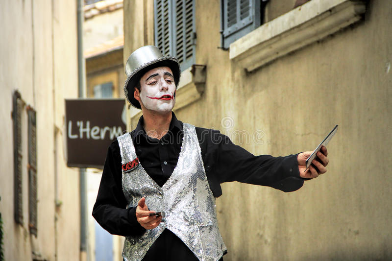 Avignon Theatre Festival. Avignon, FRANCE – July 19, 2014: Actor in historical costume advertising his performanceduring famous theatre festival from July stock photography