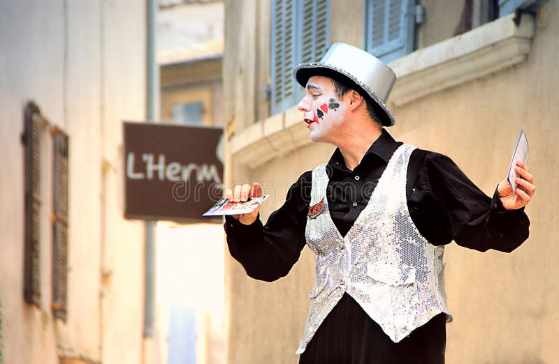Avignon Theatre Festival. AVIGNON, FRANCE – JULY 19, 2014: Actor on stilts advertising his performance during famous theatre festival from July 4 to 27 royalty free stock photos