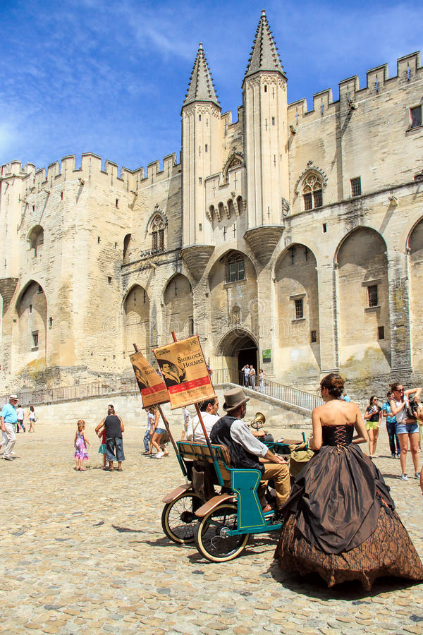 Avignon Theatre Festival. AVIGNON, FRANCE – JULY 19, 2014: Actors in historical costumes advertising their performance in front of the Papal Palace during stock images