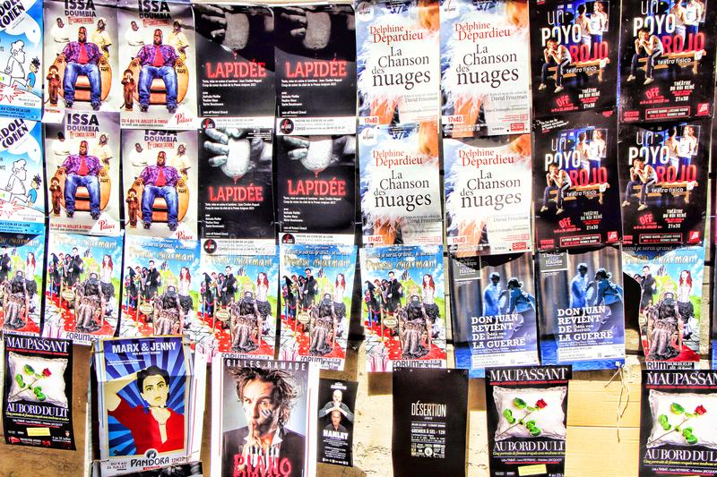 Avignon Theatre Festival. AVIGNON, FRANCE – JULY 05, 2015: plenty of playbills on a wall during famous theatre festival from July 03 to 26, 2015 in royalty free stock image