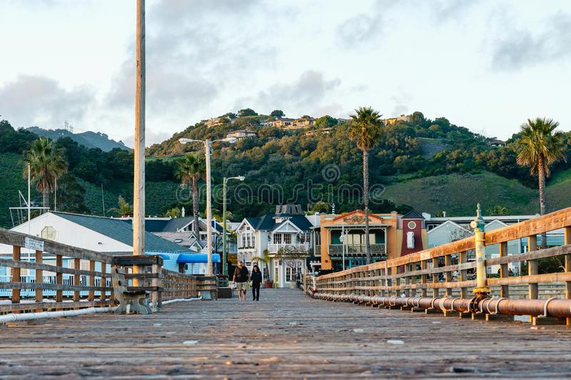 People Walking on the Pier in Small Town Avila Beach, Pacific Coast, California stock photo