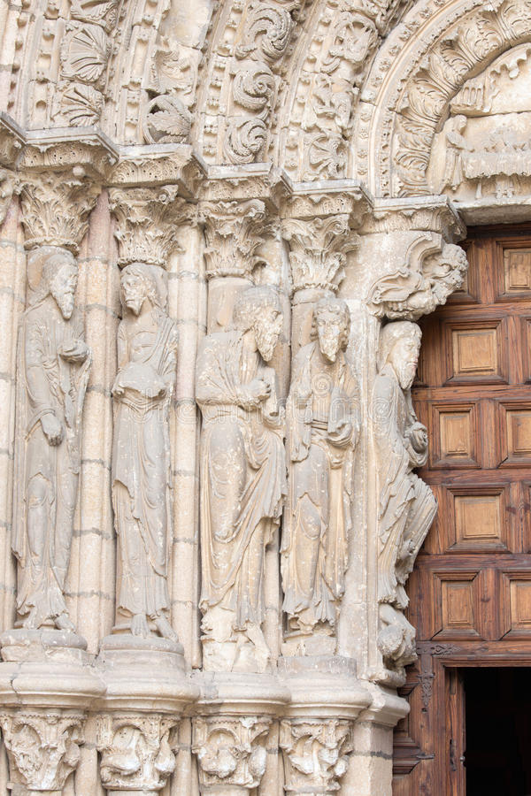 AVILA, SPAIN, APRIL - 19, 2016: The left part of romanesque west portal of Basilica de San Vicente with the apostles. 1130.  stock photos