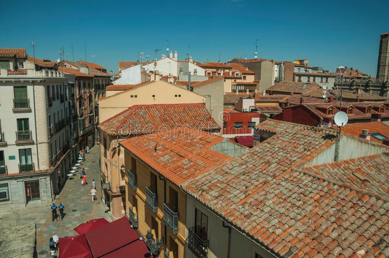 Cityscape with people walking on alley and roofs at Avila stock photography