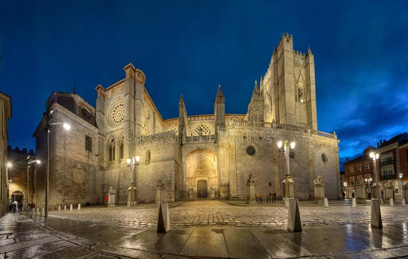 Avila, Spain. Panoramic view of Romanesque-Gothic cathedral  at dusk royalty free stock images