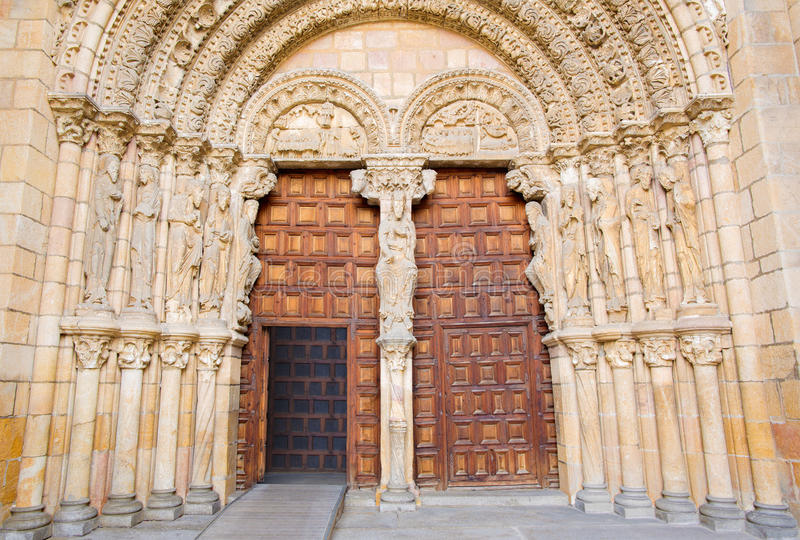 AVILA, SPAIN: The romanesque west portal of Basilica de San Vicente with the apostles. (1130). AVILA, SPAIN, APRIL - 19, 2016: The romanesque west portal of royalty free stock images