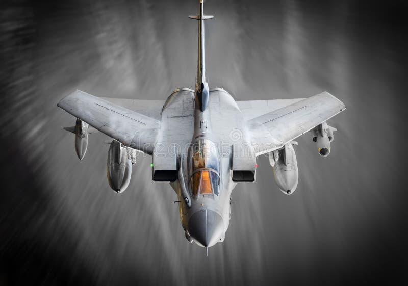 Avion de chasse en vol image stock