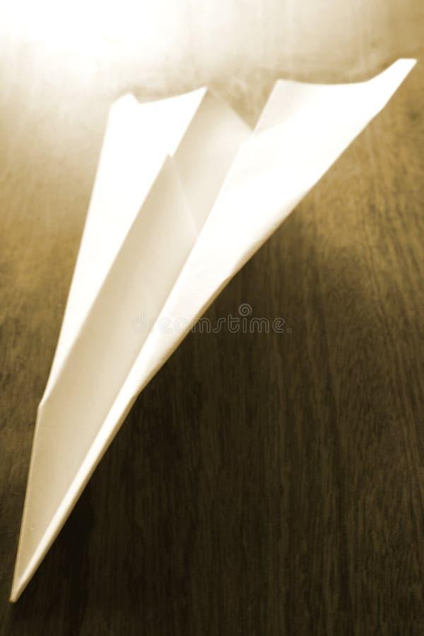 Avion de papier plié photo stock