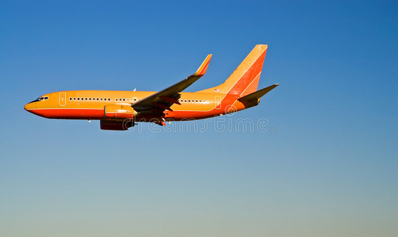 Avion de passager en vol - 2 images stock