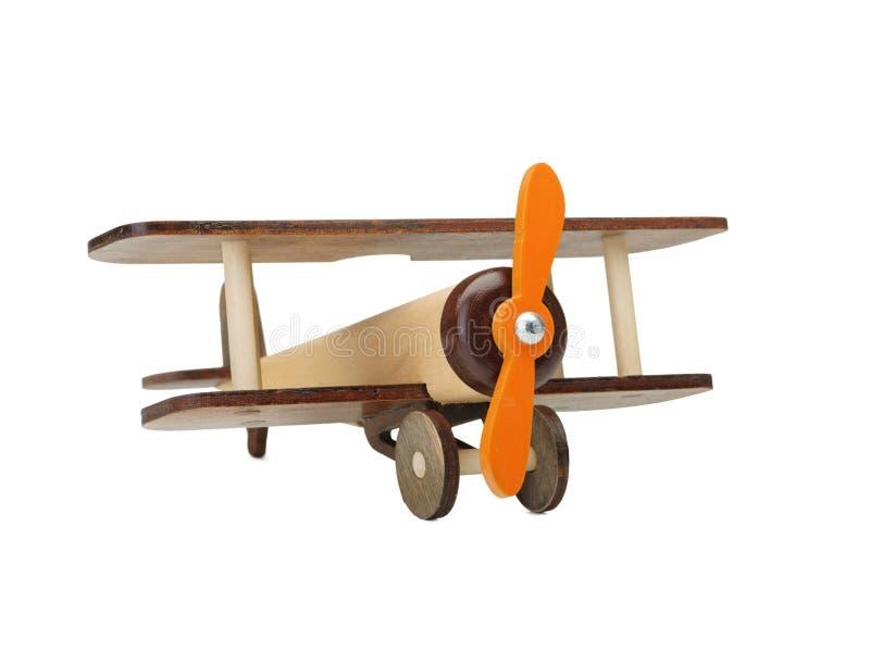 Avion en bois de jouet d'isolement sur le blanc Jouet en bois du ` s d'enfants écologie image stock