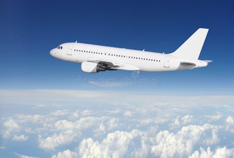 Aviones en la superficie del claro del cielo foto de archivo